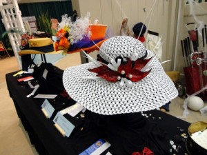 "Special Exhibits Artistic Crafts ""Buttons & Bows"" hat decorated with plant material"