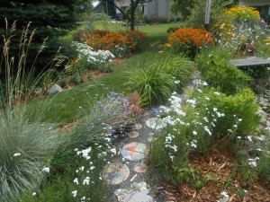 Decorative walk way through front yard's garden.
