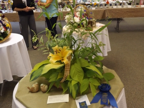 "Blue ribbon and Award of Design Excellence in the design class ""Flower Basket Quilt."""